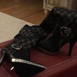 Black leather an fabric high heeled boots
